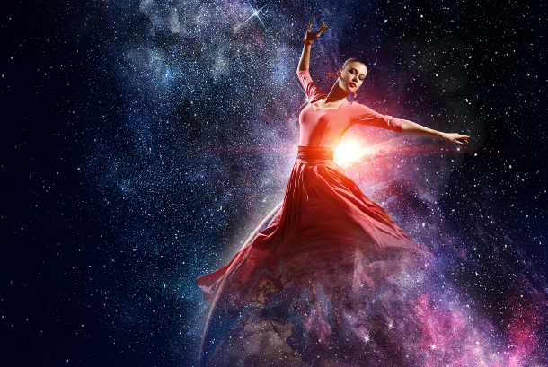 Young beautiful woman wearing red dress in space